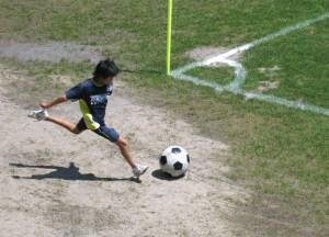 Kids always make soccer balls look so big!